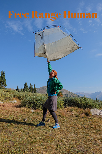 Free Range Human Heather Holding A Tent