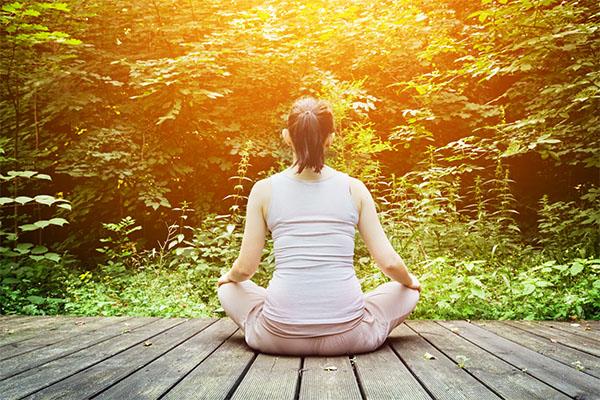 woman meditation on wooden deck