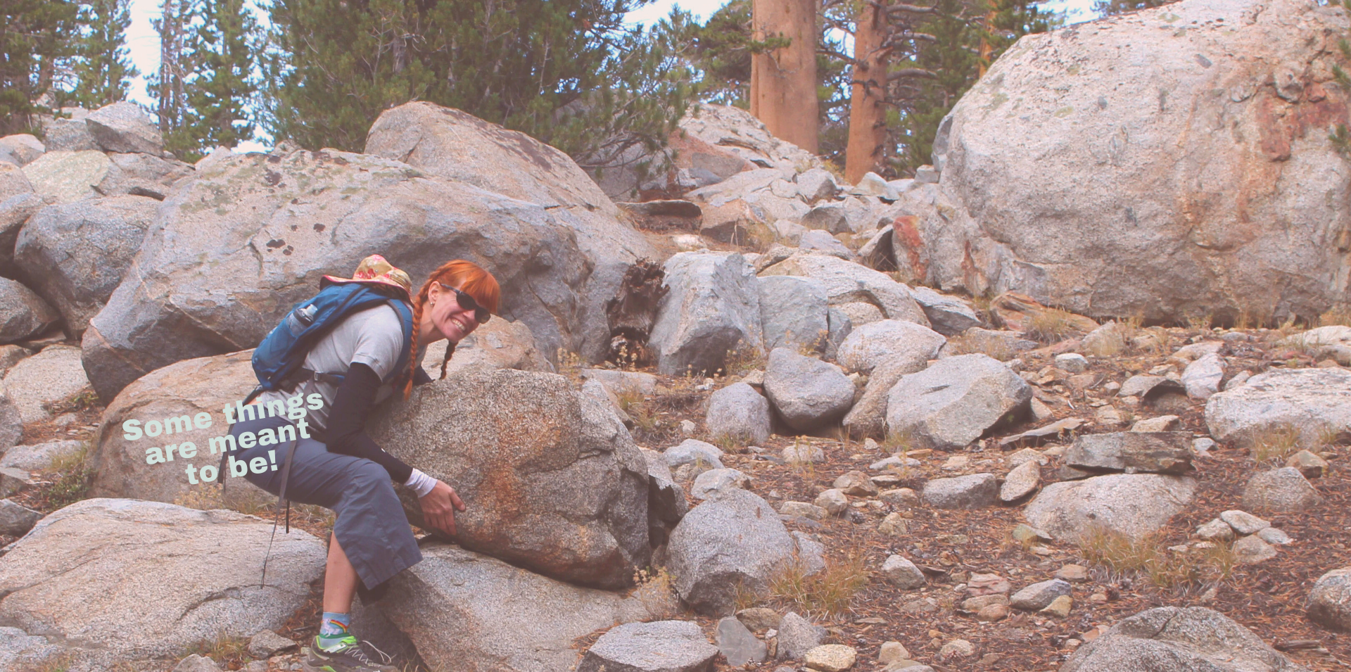Heather trying to life a large boulder