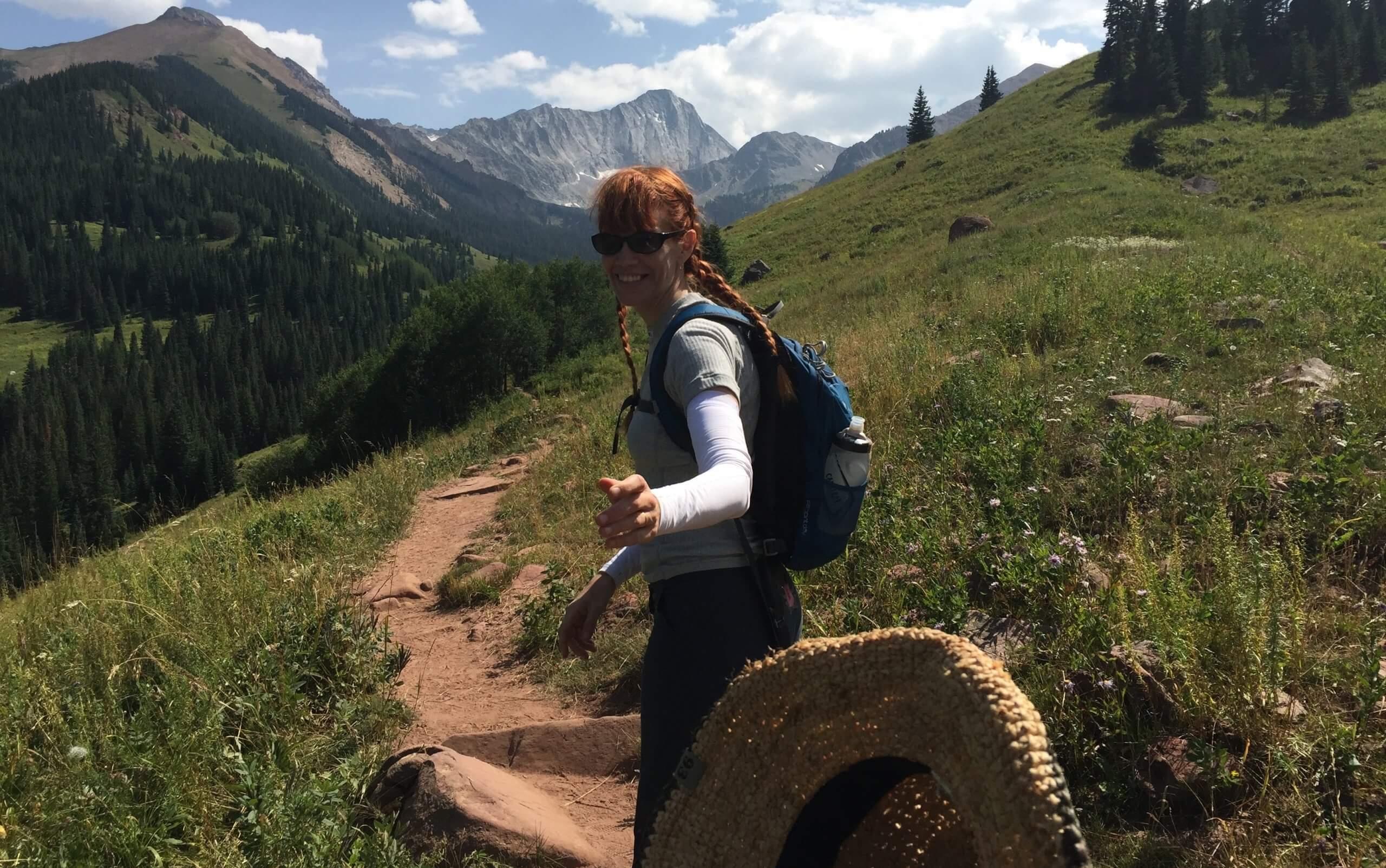 Photo of Heather walking into mountains